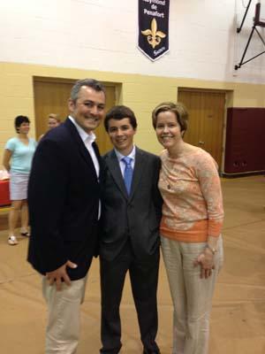 Between his parents Brian and Linda!